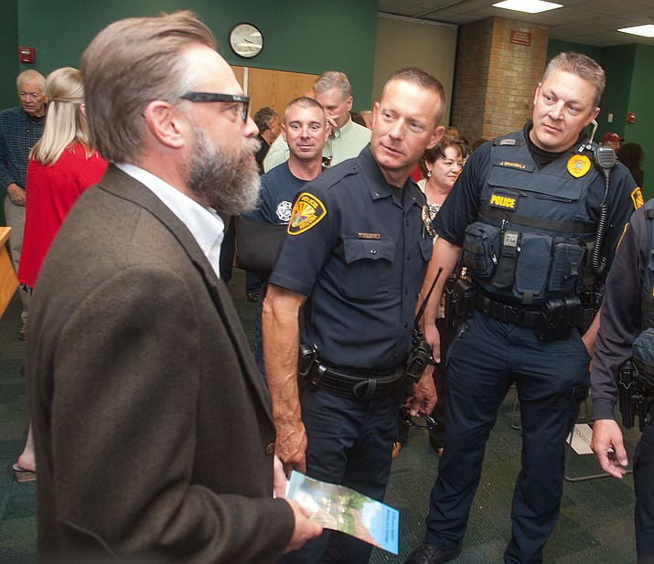 Michael Lamar talks with Prescott Police Lieutenants Rich Gill and Jon Brambila during his swearing-in and public meet and greet of the City of Prescott's newest City Manager Monday, October 10 at the Prescott Public Library.  (Les Stukenberg/The Daily Courier Photo)