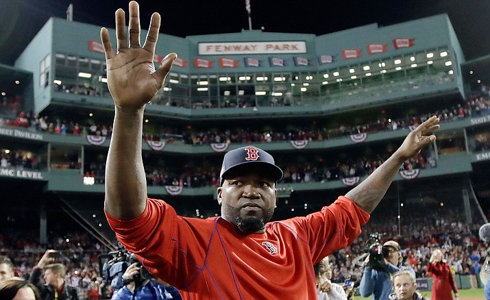 Boston Red Sox's David Ortiz waves from the field at Fenway Park after Game 3 of baseball's American League Division Series against the Cleveland Indians, Monday, Oct. 10, in Boston. The Indians won 4-3 to sweep the Red Sox in the series. Ortiz said he will retire at the end of the season.