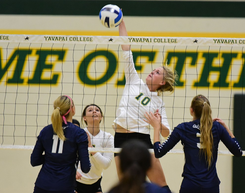 Yavapai's Bailey Anderson (10) makes a hard kill as the Lady Roughriders take on Pima Community College Wednesday night in Prescott.   (Les Stukenberg/The Daily Courier Photo)