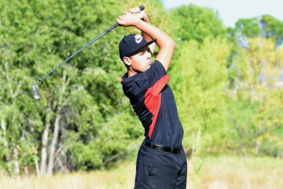 Bradshaw Mountain's #1 Carson Randa hits an approach shot in a home match against Prescott, Mingus Union and Mohave Academy High Schools Tuesday, October 11, 2017 at Prescott Golf and Country Club. (Les Stukenberg/The Daily Courier)