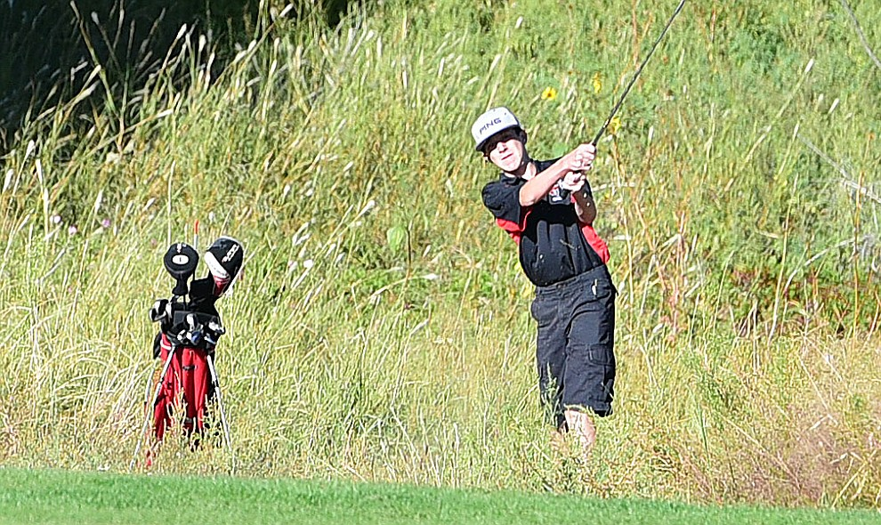 Bradshaw Mountain's #3 Cayden Healey hits from a hazard in a home match against Prescott, Mingus Union and Mohave Academy High Schools Tuesday, October 11, 2017 at Prescott Golf and Country Club. (Les Stukenberg/The Daily Courier)