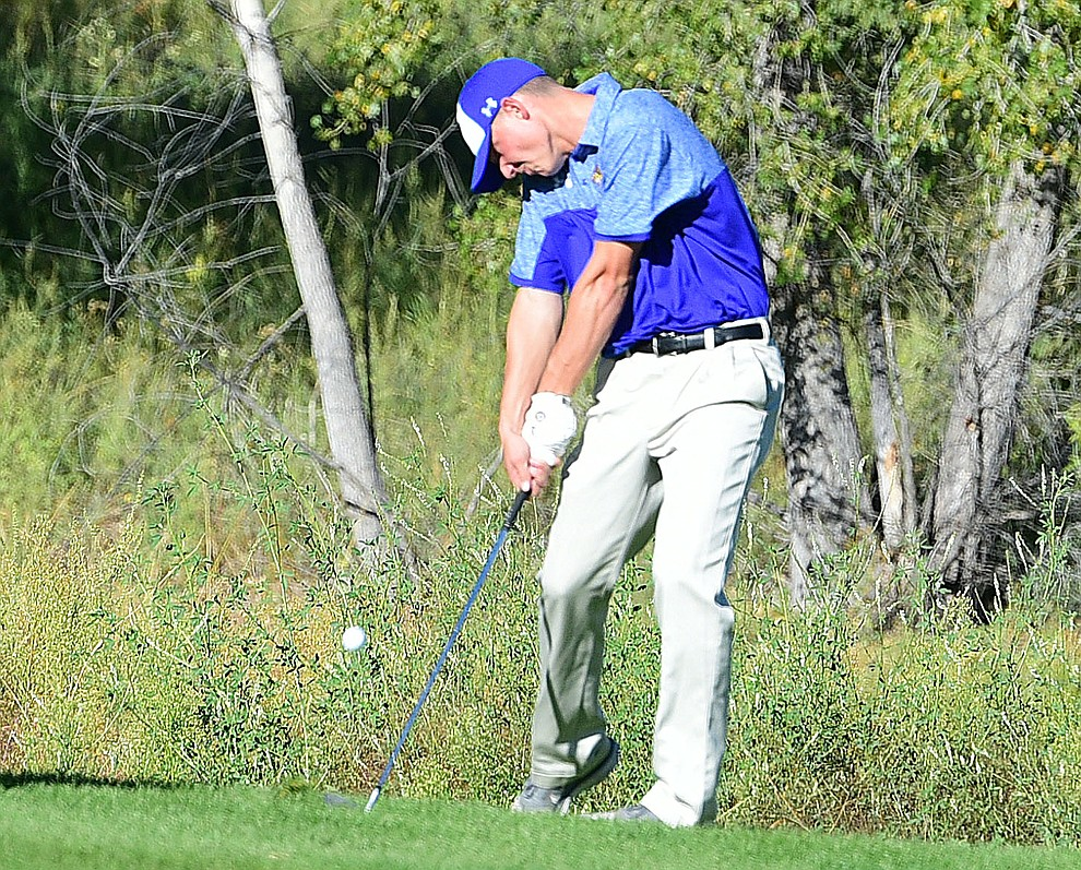 Prescott's Chase Kasun hits an approach shot in a match against Bradshaw Mountain, Mingus Union and Mohave Academy High Schools Tuesday, October 11, 2017 at Prescott Golf and Country Club. (Les Stukenberg/The Daily Courier)