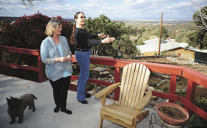 In this March 2016 file photo, Nancy Paola and her neighbor Millie Owens talk about their concerns about possible group homes in their neighborhood.