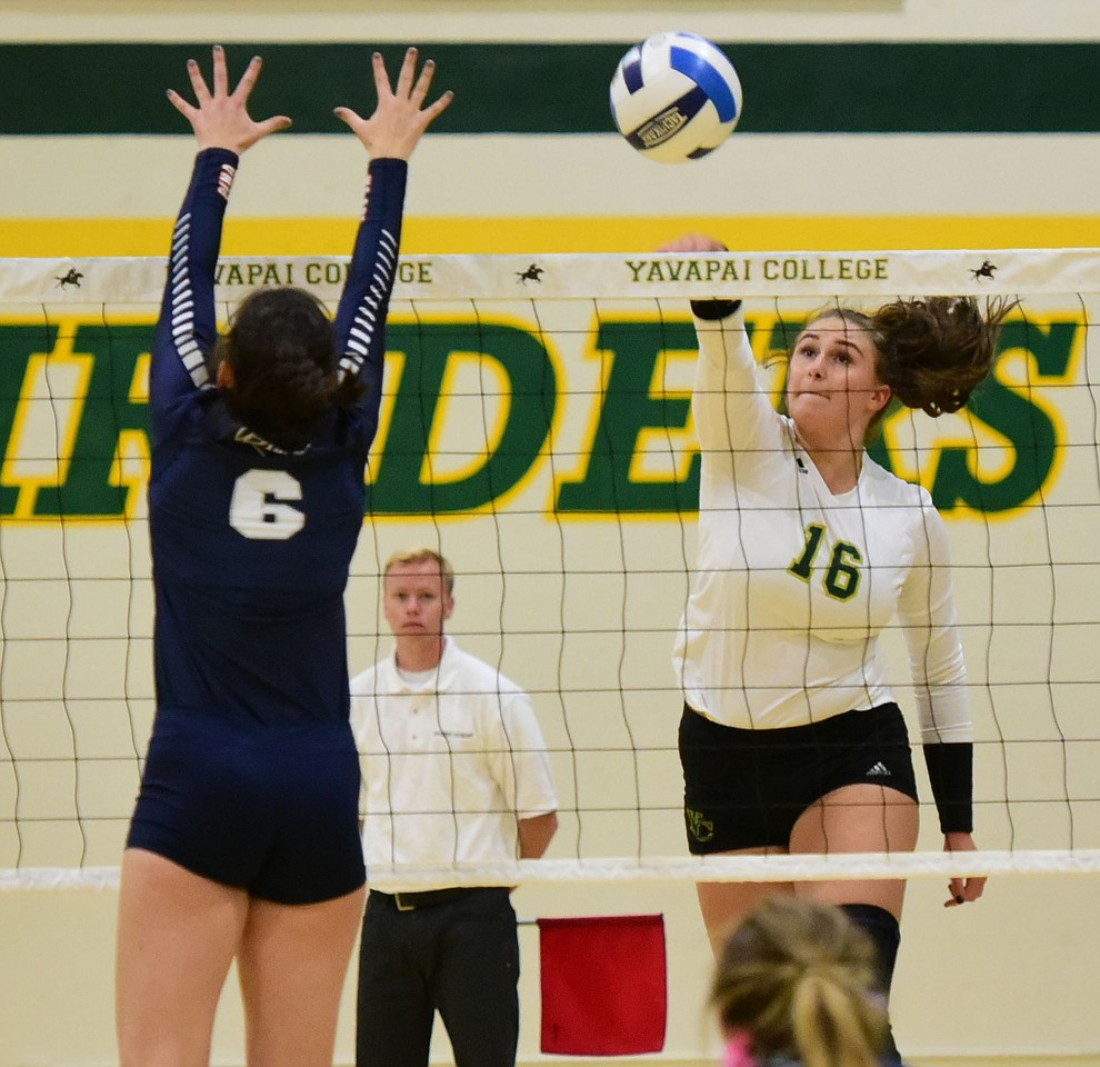 Yavapai's Iva Alebic (16) drives a kill down the side as the Lady Roughriders take on Pima Community College Wednesday night in Prescott.   (Les Stukenberg/The Daily Courier Photo)