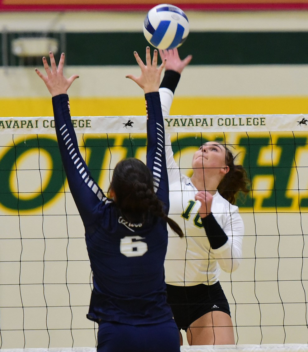 Yavapai's Iva Alebic (16) hits a winner as the Lady Roughriders take on Pima Community College Wednesday night in Prescott.   (Les Stukenberg/The Daily Courier Photo)