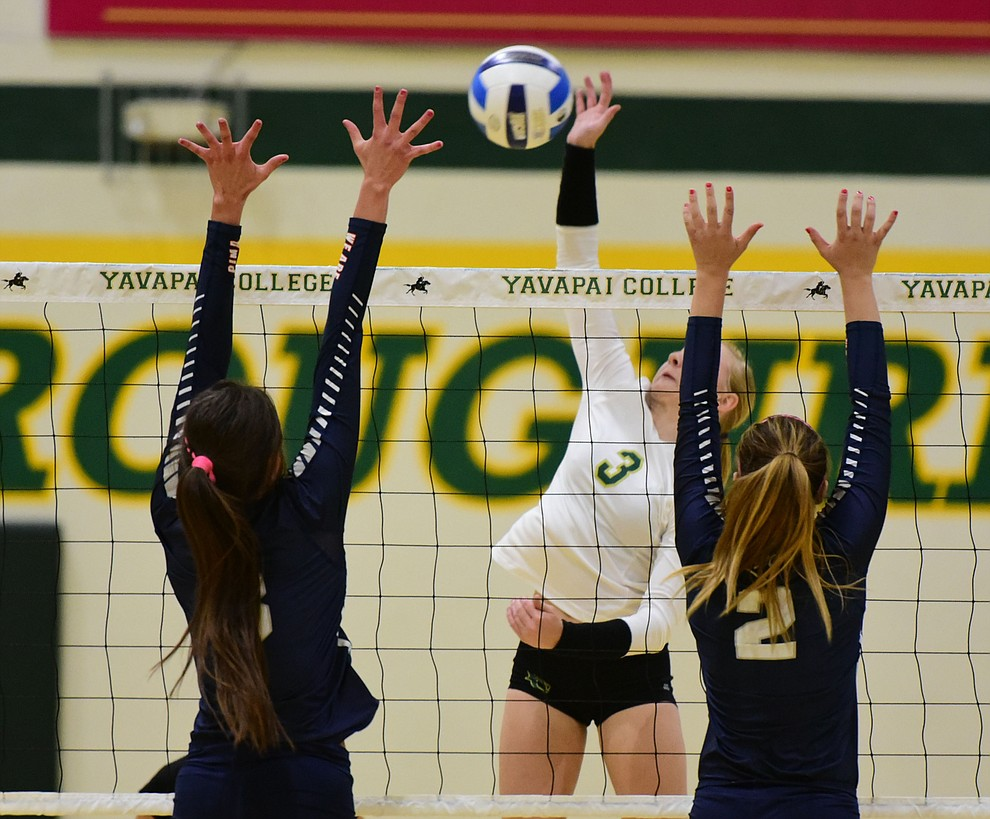 Yavapai's Jailynn Butler (3) powers home a kill as the Lady Roughriders take on Pima Community College Wednesday night in Prescott.   (Les Stukenberg/The Daily Courier Photo)