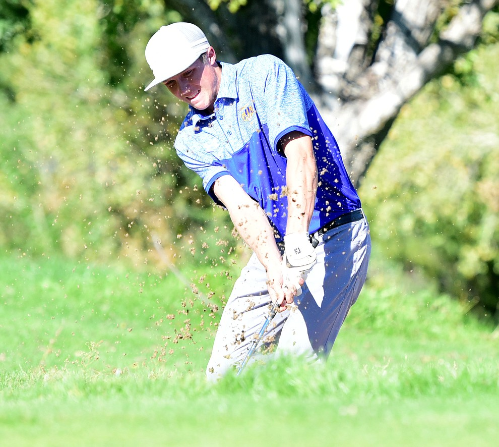 Prescott's Joey Christopherson hits from a bunker in a match against Bradshaw Mountain, Mingus Union and Mohave Academy High Schools Tuesday, October 11, 2017 at Prescott Golf and Country Club. (Les Stukenberg/The Daily Courier)