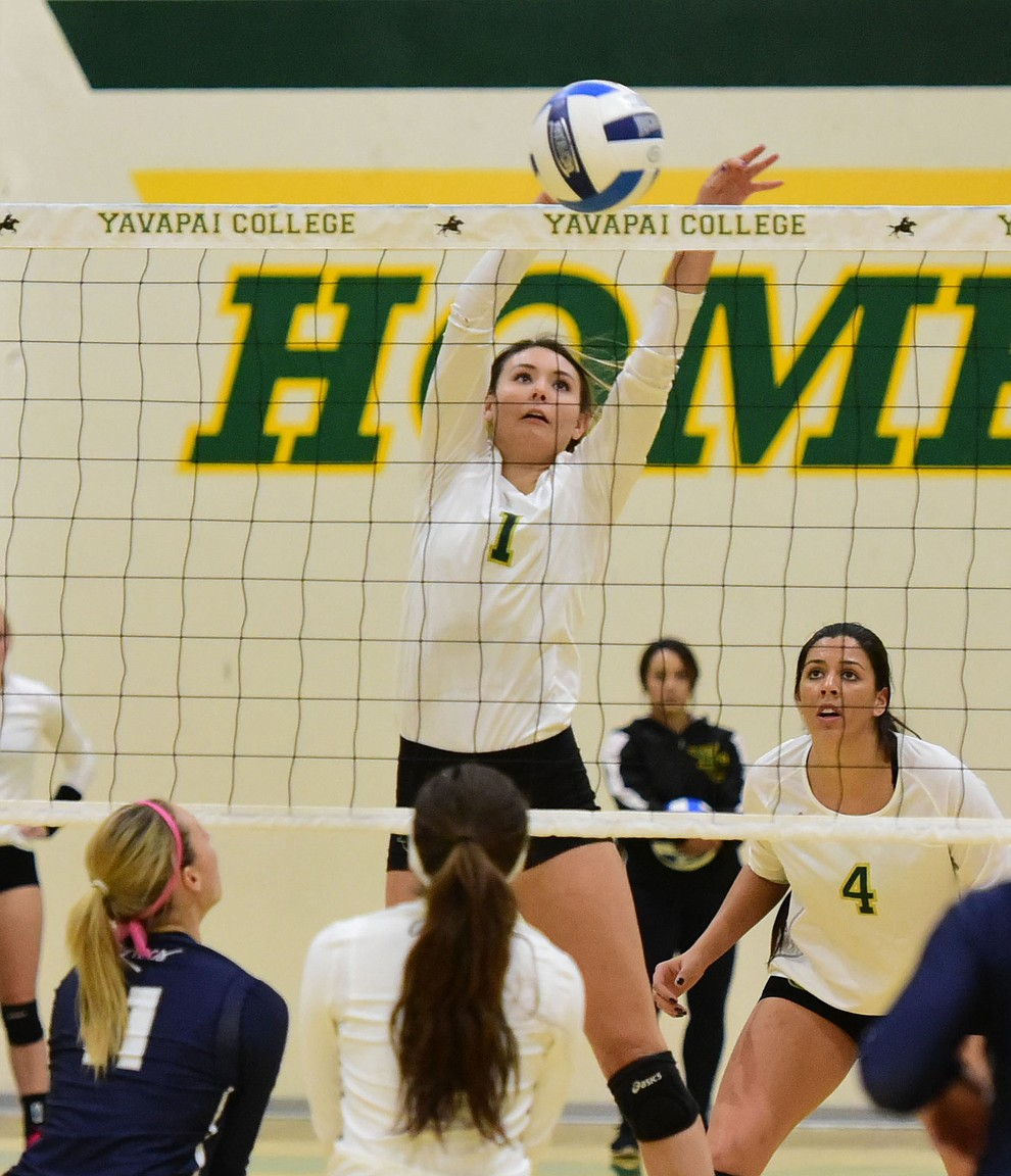 Yavapai's Jordan Tilley (1) makes a block as the Lady Roughriders take on Pima Community College Wednesday night in Prescott.   (Les Stukenberg/The Daily Courier Photo)