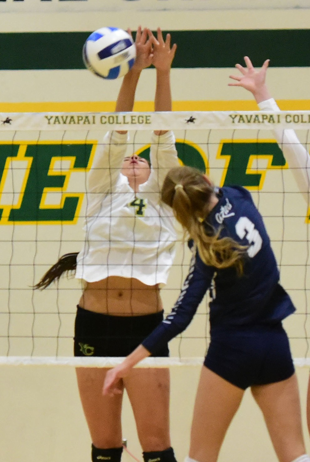 Yavapai's Kaytlin Yost (4) makes a block as the Lady Roughriders take on Pima Community College Wednesday night in Prescott.   (Les Stukenberg/The Daily Courier Photo)