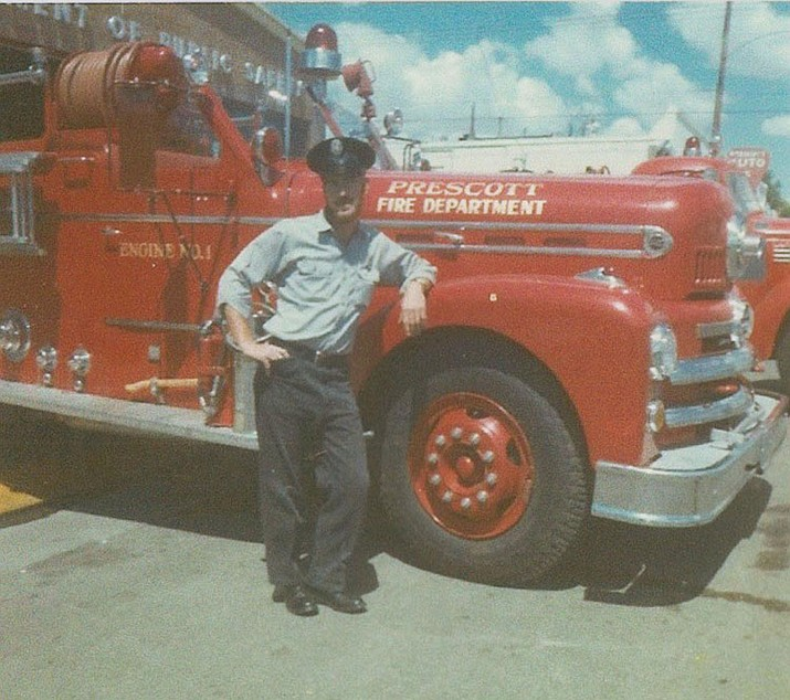 Harvey S. Emery Jr. standing next to a 1930s Ward LaFrance fire engine.