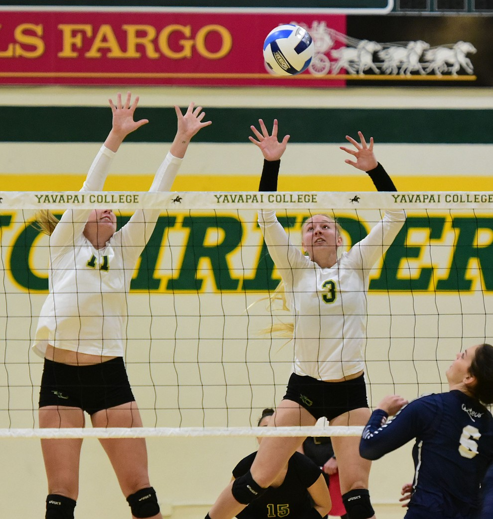 Yavapai's Baylie Stephens (11) and Jailynn Butler (3) get a block as the Lady Roughriders take on Pima Community College Wednesday night in Prescott. (Les Stukenberg/The Daily Courier Photo)