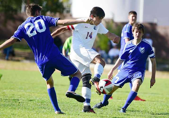 Chino Valley's Arturo Gomez (14) scores as the Cougars take on Northland Prep Academy in Chino Valley Thursday, October 13. (Les Stukenberg/The Daily Courier)
