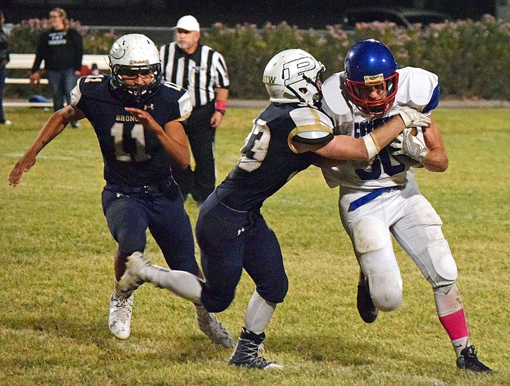 Camp Verde ran a clock-consuming, ball-control offense against Parker Friday to roll to a 21-0 victory and improve the Cowboys' season record to 3-5.