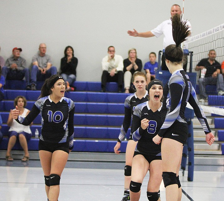 Shaunti Short (10), Breezy Weber (8) and Aspen Jackson, (in back) react to Grace Herbine's kill during the Lady Tigers three sets to one win over Antelope Thursday at KAHS.