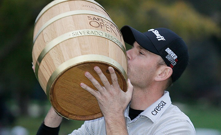 Brendan Steele kisses his trophy on the 18th green of the Silverado Resort North Course after winning the Safeway Open PGA golf tournament Sunday, Oct. 16, in Napa, Calif.