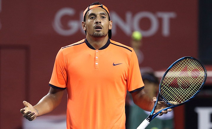 In this Saturday, Oct. 8, 2016, file photo, Australia's Nick Kyrgios reacts after getting a point against Gael Monfils of France during the semifinal match of Japan Open tennis championships in Tokyo.  The ATP has suspended Nick Kyrgios for at least 3 weeks and fined him extra $25,000 for conduct contrary to 'integrity' of tennis.