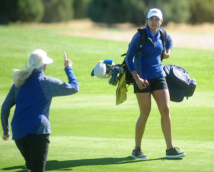 Embry Riddle Head Golf Coach Kim Haddow, at left, talks with Lauren Kruszewski on the first hole Monday during the Embry-Riddle Invitational at Talking Rock Golf Club in Prescott.