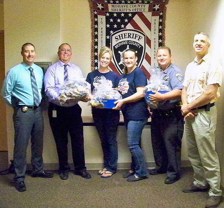 Local residents Jaclyn Chapman and Jennifer Allen (center) presented (left to right) Capt. Dean McKie, Chief Deputy Rodney Head, Deputy Troy Schmotzer and Deputy Kelly McCool with baskets of cookies.