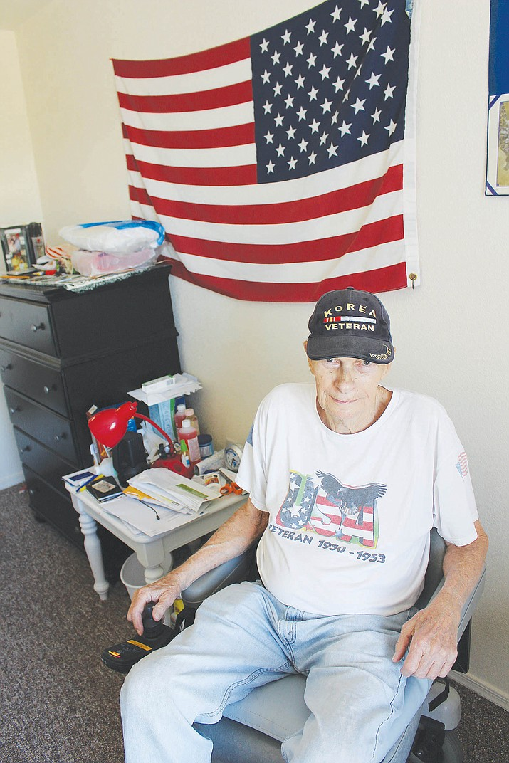 Korean War veteran Louis Shannon sits Friday in his new battery-powered wheelchair, which was purchased for him by caring members in the community after his old one broke down.