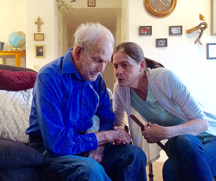 Sally Carter, right, chats with her grandfather, WWII veteran Anthony Bermel, at the Diamond Valley home where she cares for him.