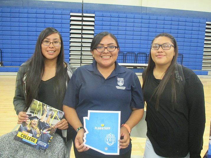 Hopi High's Breanna Saufkie and Brenda Dacawyma learned about NAU from Aleandra Hoyungowa. Photo/Stan Bindell