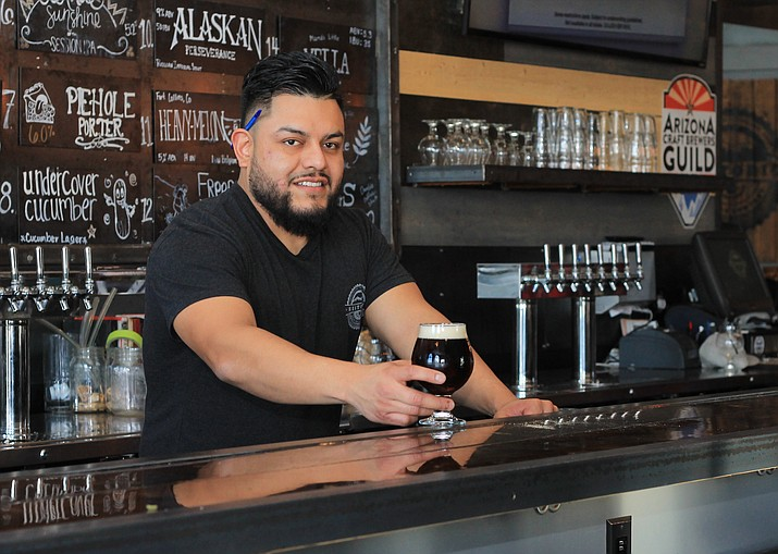Bartender Luis Alvarado serves up a beer at the Historic Brewing Co. in Williams. The tavern was the only brewery in Arizona to bring home an award at the Great American Beer    Festival in Denver Oct. 6 - 8.