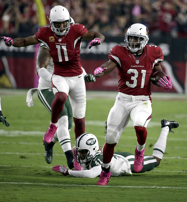 Arizona Cardinals running back David Johnson (31) runs for a touchdown against the New York Jets as teammate Larry Fitzgerald (11) follows during their  game Monday, Oct. 17, in Glendale.