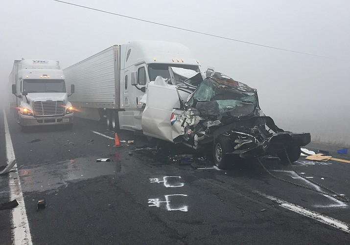 A fatal collision involving two semi-trailers and a passenger vehicle closed down traffic on Interstate 40 early Wednesday morning.