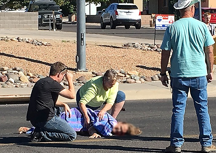 Passersby assist a woman who was struck by a pickup truck in the 2900 block of Stockton Hill Road around 2:30 p.m. Monday.