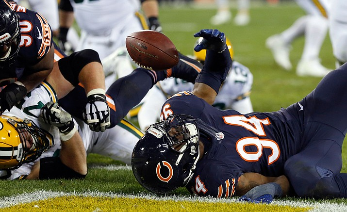 Chicago Bears outside linebacker Leonard Floyd (94) chases a fumble by Green Bay Packers quarterback Aaron Rodgers (12) for a touchdown during the second half of an NFL football game, Thursday, Oct. 20, in Green Bay, Wis.