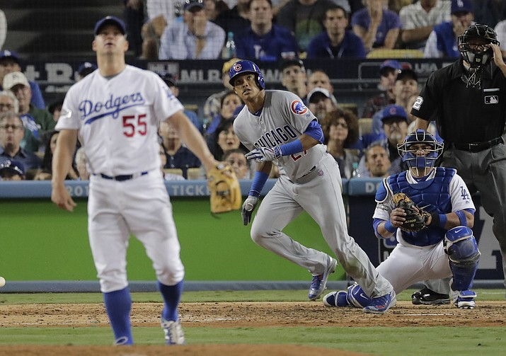 Chicago Cubs' Addison Russell hits a two-run home run off Los Angeles Dodgers relief pitcher Joe Blanton during the sixth inning of Game 5 of the National League baseball championship series Thursday, Oct. 20, in Los Angeles.