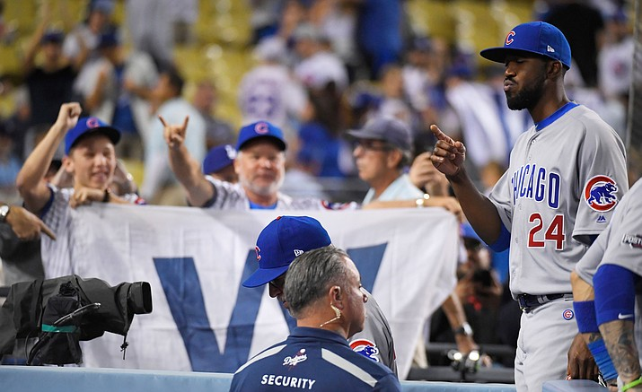 Chicago Cubs' Dexter Fowler celebrates after Game 4 of the National League baseball championship series against the Los Angeles Dodgers Wednesday, Oct. 19, in Los Angeles. The Cubs won 10-2 to tie the series 2-2.