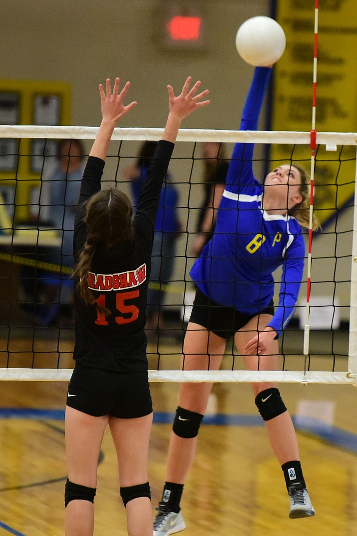 Prescott's Abbey Smith (8) hits a winner as Randee Clifford (15) of Bradshaw Mountain High goes up to block in this match on Sept. 15. The Prescott Lady Badgers beat the Bradshaw Mountain Lady Bears in a volleyball matchup Wednesday, Oct. 19.