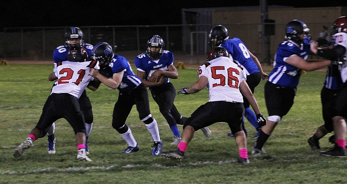 Kingman Academy's Jordan McDowell-Seybert scans the field for running room on his way to 235 yards in last week's win over Tonopah Valley at Southside Park.