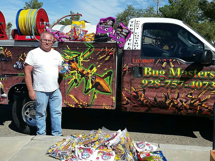 Derrell Davidson of Bug Masters donates goodies for the 43rd annual Pumpkin Patrol. Donations are still being accepted.