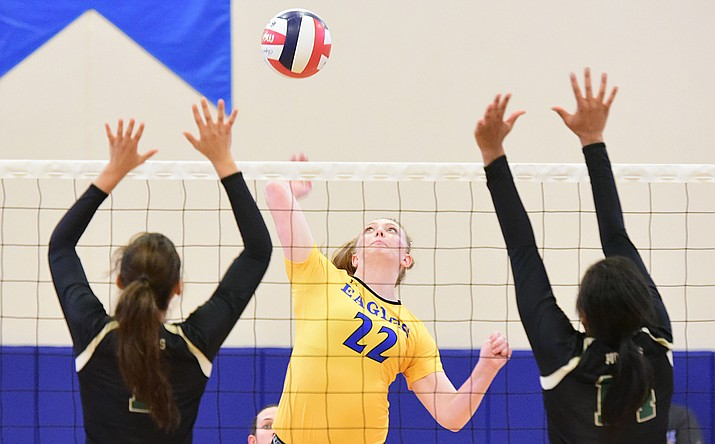 Embry Riddle's Lyndsey Weiler (22) sends a hard kill as the Lady Eagles take on Pacific Union College Friday afternoon in Prescott. (Les Stukenberg/The Daily Courier)