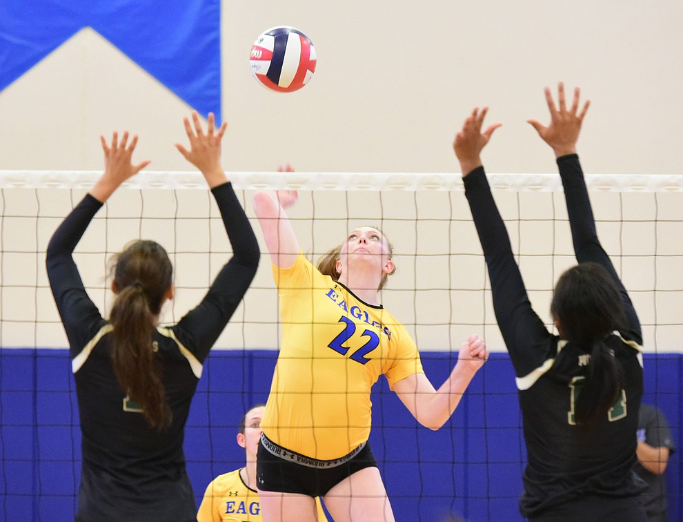 Embry Riddle's Lyndsey Weiler (22) sends a hard kill as the Lady Eagles take on Pacific Union College Friday afternoon in Prescott.