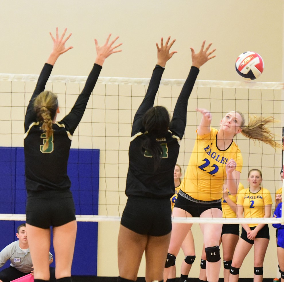 Embry Riddle's Lyndsey Weiler (22) sends a kill down the line as the Lady Eagles take on Pacific Union College Friday afternoon in Prescott.