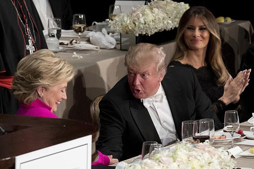Republican presidential candidate Donald Trump, center, accompanied by his wife Melania Trump, right, shakes hands with Democratic presidential candidate Hillary Clinton, left, after they both speak at the 71st annual Alfred E. Smith Memorial Foundation Dinner, a charity gala organized by the Archdiocese of New York, Thursday, Oct. 20, 2016, at the Waldorf Astoria hotel in New York.