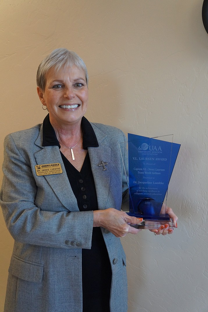 Dr. Jackie Luedtke of Embry-Riddle Aeronautical University's Prescott campus accepting the V.L. Laursen Award.