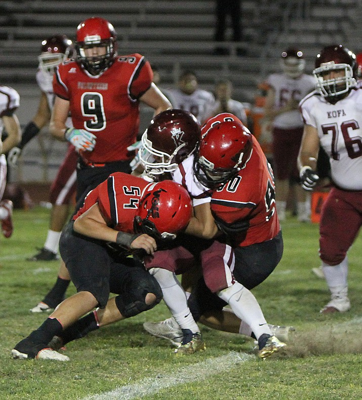 Lee Williams' Matt Shaw (54) and Kael Juelfs (90) take care of a Kofa ball carrier during the Vols' 14-13 win Friday at LWHS. Juelfs and Shaw combined for 25 tackles in the win.