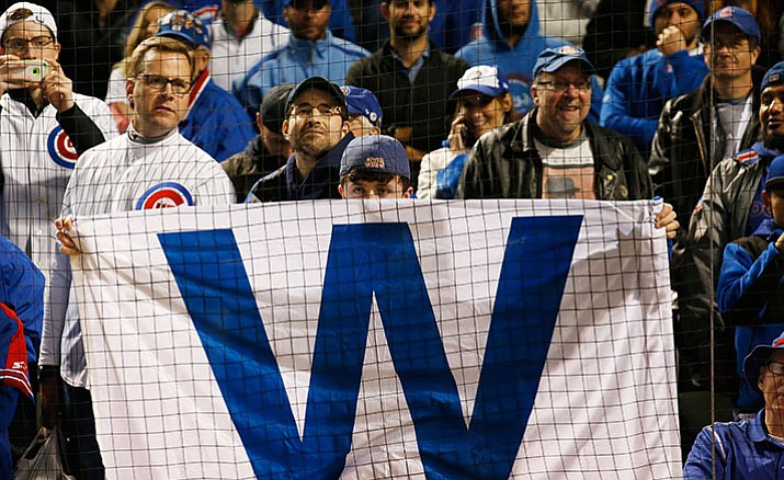 Chicago Cubs Fans celebrate after Game 6 of the National League baseball championship series against the Los Angeles Dodgers, Saturday, Oct. 22, in Chicago. The Cubs won 5-0 to win the series and advance to the World Series against the Cleveland Indians.