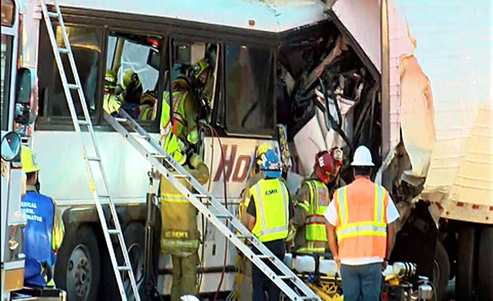 This photo shows the scene of crash between a tour bus and a semi-truck on Interstate 10 in Desert Hot Springs, near Palm Springs, in California's Mojave Desert Sunday, Oct. 23. Several deaths and injuries were reported.