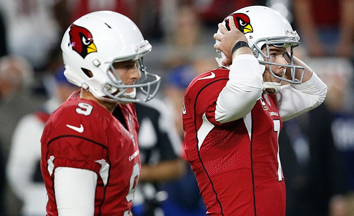 Arizona Cardinals kicker Chandler Catanzaro, right, reacts to missing a game-winning field goal as punter Ryan Quigley looks on, during overtime of an NFL football game against the Seattle Seahawks, Sunday, Oct. 23, in Glendale. The game ended in overtime in a 6-6 tie.