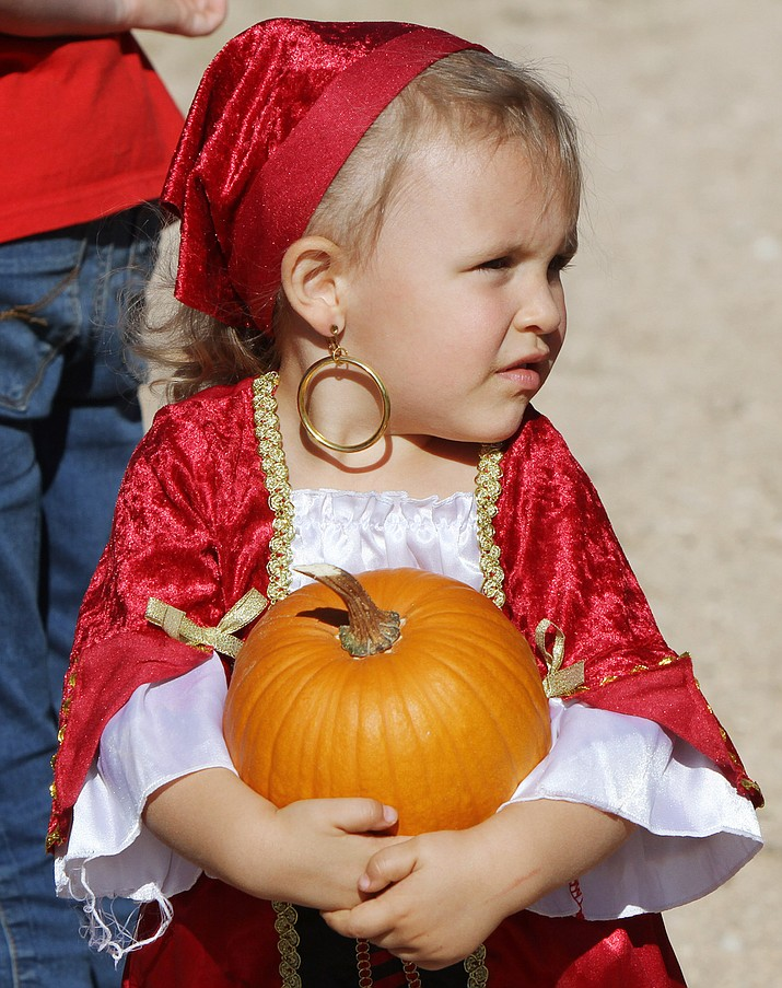 Zoey Wigal, 2, dressed as a pirate for the DIG It Pumpkin Patch Day event.