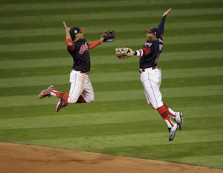 Cleveland Indians' Francisco Lindor and Rajai Davis celebrate after Game 1 of the Major League Baseball World Series against the Chicago Cubs Tuesday, Oct. 25, in Cleveland. The Indians won 6-0 to take a 1-0 lead in the series.