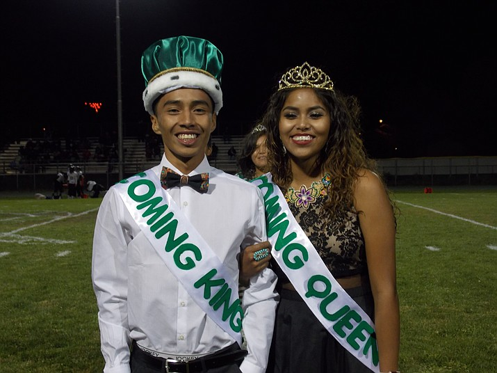 Tuba City High School's Homecoming King Terrell Arizona and Homecoming Queen Alisa Yazzie pose for pictures on the 50-yard line at the Homecoming game. Tuba City beat Chinle 6-0.