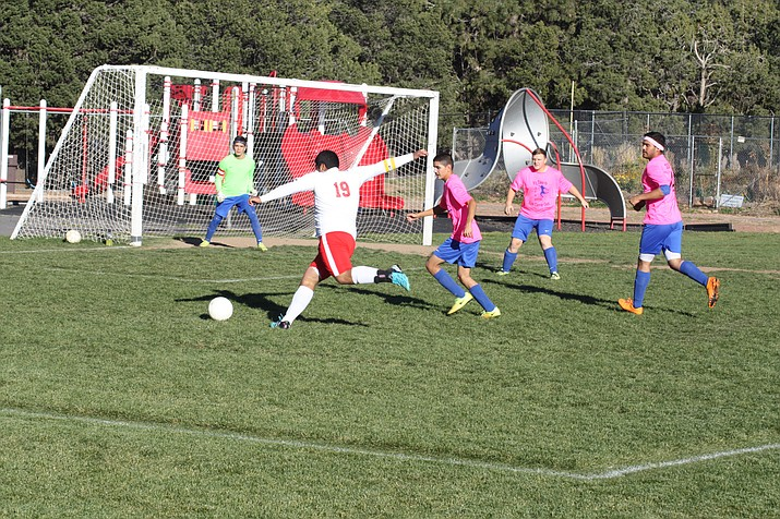 Israel Herrera attempts a shot on goal.