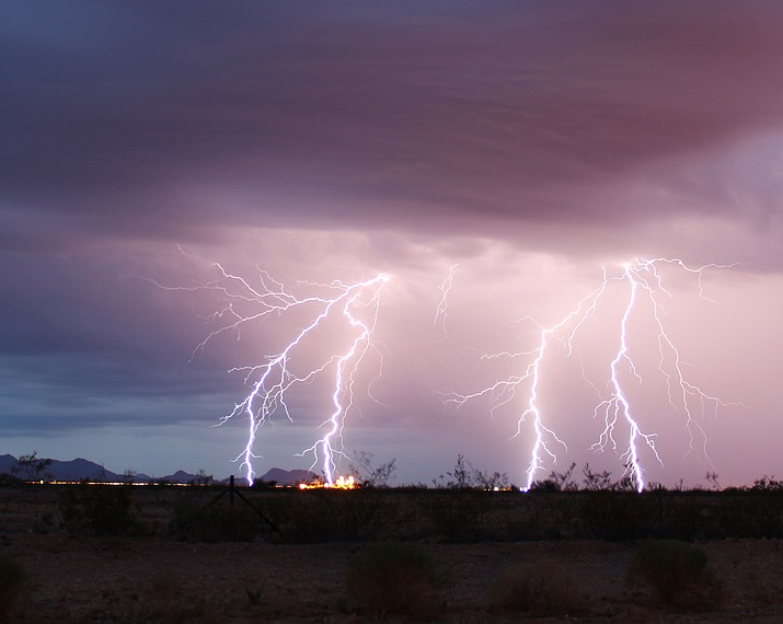 The photographer took these shots of lightning during Monday's storm at sunset as she drove on I-40 with the Griffith Energy Plant in the distance.