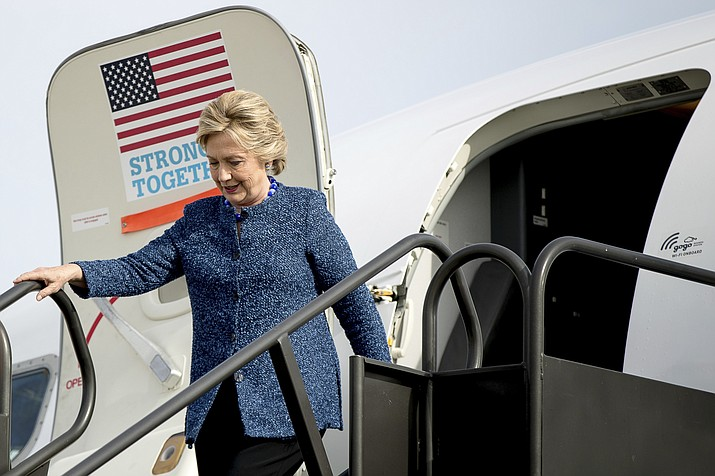 Democratic presidential candidate Hillary Clinton arrives at Eastern Iowa Airport in Cedar Rapids, Iowa, Friday, Oct. 28, 2016, to attend a rally.